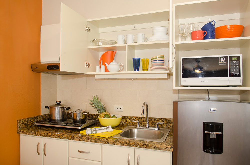 Kitchen is fully equipped in you apartment at La Sabana.